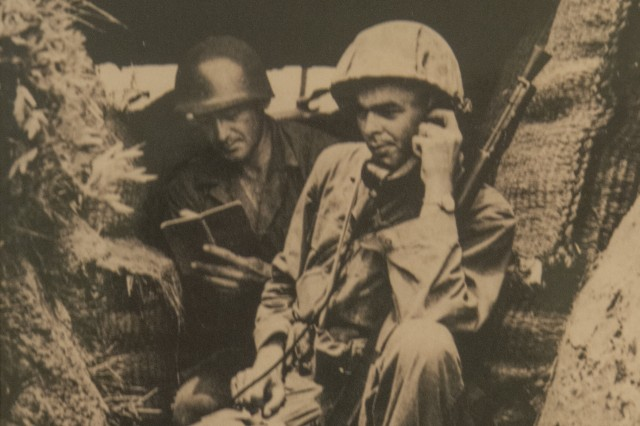 """U.S. Army 2nd Lt. William H. Funchess (on radio) and Sgt. O.J. Mixon, both in the 19th Infantry Regiment, maintain cover in a bunker on the bank of the Kum River north of Taejon, South Korea, July, 1950. """"That was my first engagement. There were 13 Russian T-34 tanks across the river firing point-blank into us."""" Funchess was captured on Nov. 4, 1950 after a fierce fight with an overwhelming Chinese force. He endured 34 months as a prisoner of war before finally being released on Sept. 6, 1953. (Photo courtesy of William Funchess)"""