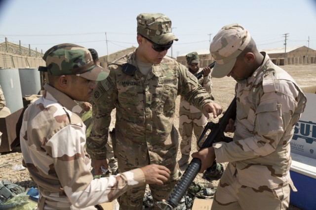 A U.S. Soldier explains some of the functions on an M16 rifle