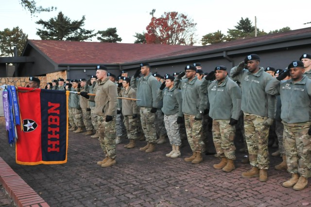 Warrior Division Soldiers from Headquarters and Headquarters Battalion, 2nd Infantry Division/ROK-U.S. Combined Division salute during a Veterans Day Observance on November 9 held at Medal of Honor Park on Camp Red Cloud.