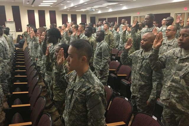 One hundred U.S. Army soldiers become new U.S. citizens at a naturalization ceremony held at Fort Lee, Virginia.