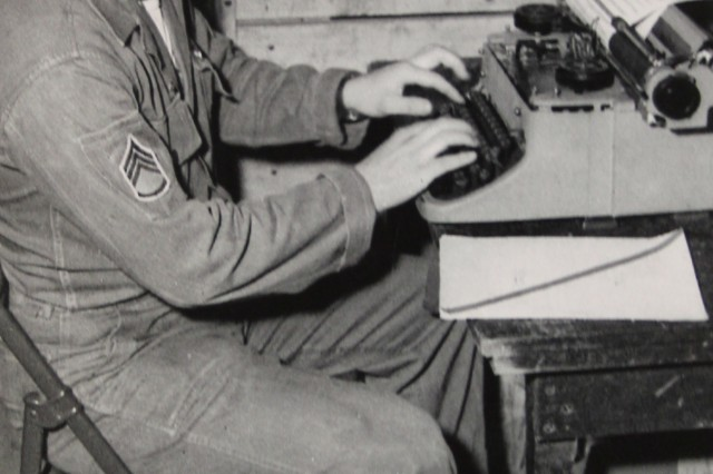 Richard W. Robinson as a clerk typist in the Army. Robinson would eventually reach the rank of sergeant major.