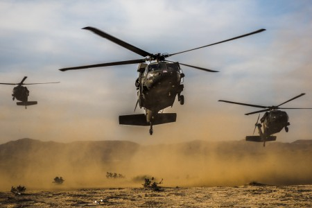 "Three UH-60 Blackhawk helicopters, carrying the U.S. Army Chief of Staff Gen. Mark A. Milley, arrive in the box at the National Training Center, Fort Irwin, Calif., Nov. 6, 2016.  During his visit with 11th Armored Cavalry Regiment ""Blackhorse Troopers,"" Milley offered insight about the future of the Army, the importance of the National Training Center and the value of finishing a college education."