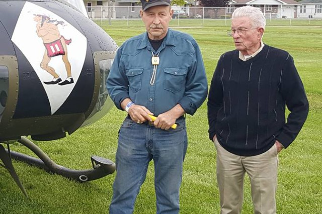 Former Staff Sgt. Dewey Smith poses with the pilot who saved his life in Vietnam, retired Lt. Col. Charles Kettles, in Ohio, May 2016. Kettles' action during that rescue mission would earn him the Medal of Honor.