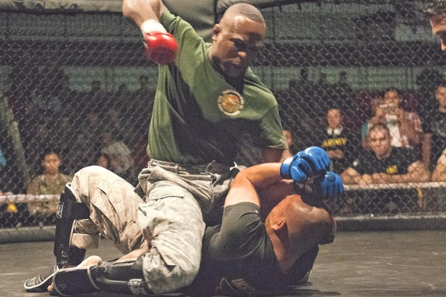 Sgt. 1st Class Jeff Duncan, U.S. Army Garrison Fort Leonard Wood, pins Marine Sgt. Be Vang, Marine Corps Detachment, in the Cruiserweight match.