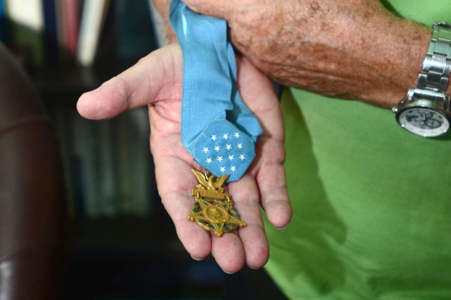 Retired Maj. Gen. Patrick Brady, a Medal of Honor recipient, displays the prestigious Congressional Medal of Honor award Sept. 29, in New Braunfels, Texas. Brady's heroic feats during the Vietnam War as a ambulatory pilot earned him the award.