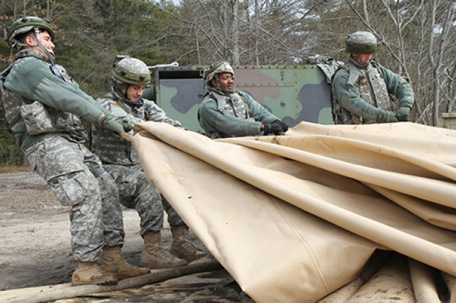 U.S. Army Soldiers of the 431st Quartermaster Company (QM Company) drain a potable water holding bag in preparation for storage at the Brindle Lake training area on Joint Base McGuire-Dix-Lakehurst, N.J., March 6, 2016. Soldiers of the 431st QM Company provide potable water to Soldiers training during Combat Support Training Exercise 78-16-01.