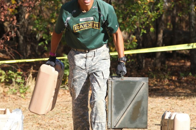 Gabriel Peralta, Haines City High School, Florida, test his physical strength and stamina during the Physical Team Test during the Army JROTC National Raider Challenge held in Molena, Georgia, Nov. 5-6.