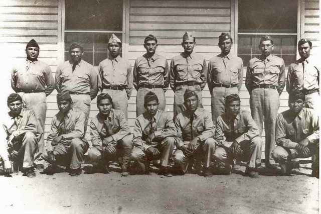 Army 4th Signal Corps Comanche Code Talkers, Fort Benning, Ga. 1941. Standing, left to right, with hometowns: Morris Sunrise Tabbyetchy (Cache-Indiahoma), Perry Noyabad (Cyril), Ralph Wahnee (Cyril-Fletcher), Haddon Codynah (Walters), Robert Holder (Walters), Albert (Edward) Nahquaddy Jr. (Walters), Clifford Otitivo (Cement-Walters), Forrest Kassanavoid (Indiahoma). Kneeling left to right: Roderick Red Elk (Walters), Simmons Parker (Cache-Indiahoma), Larry Saupitty (Mt. Scott-Porter Hill), Melvin Permansu (Walters), Willie Yackeschi (Walters), Charles Chibitty (Mount Scott-Porter Hill), Wellington Mihecoby (Geronimo).