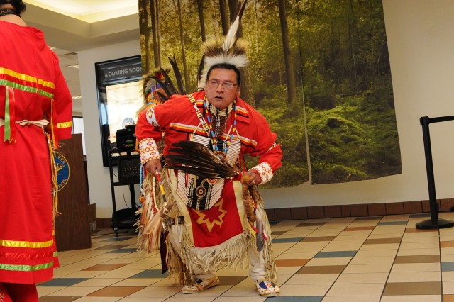 Richard Greybull, veteran and member of the Dakota tribe, performs a tribal dance.