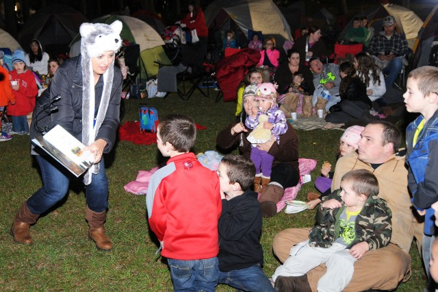 Col. Shannon T. Miller, Fort Rucker garrison commander, reads to children at last year's Camping Under the Stars.
