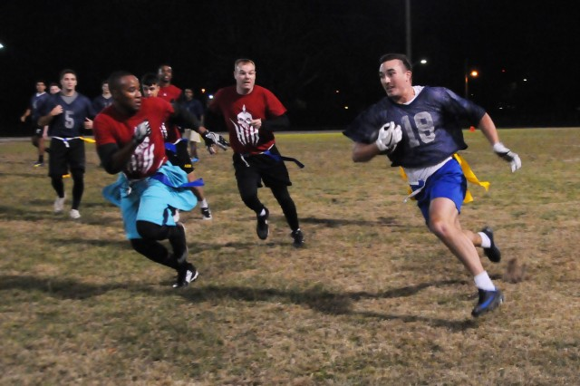 Players battle it out on the field during an intramural football game at the Fort Rucker Physical Fitness Center football field Nov. 8.