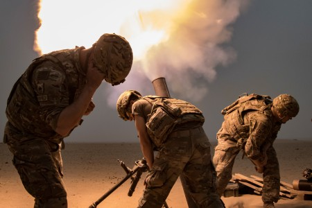 Mortar Soldiers with the 77th Armored Regiment, 3rd Brigade, 1st Armored Division, fire a 120mm mortar round to provide indirect, suppressive fire for Infantry Soldiers during a squad live-fire exercise, Nov. 3, 2016, at Udari Range near Camp Buehring, Kuwait. Mortar fire was part of the four-day training exercise that synchronized the capabilities of infantry Soldiers, indirect fire infantrymen and forward observers.