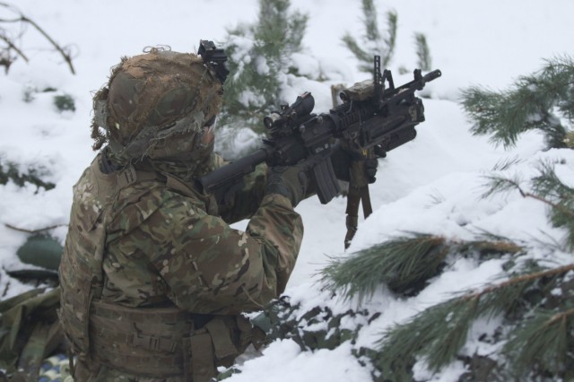 "ADAZI, Latvia - A Paratrooper assigned to Battle Company, 2nd Battalion, 503rd Infantry Regiment, 173rd Airborne Brigade, prepares to fire an M203 grenade launcher from his fighting position during Exercise Steel Shield at Camp Adazi, Latvia, Nov. 7, 2016. Steel Shield partnered U.S. Paratroopers with the Estonian Scouts Battalion, based out of Paldiski, Estonia, to conduct live-fire defensive operations. The ""Sky Soldiers"" of B Co., 2nd Bn., 503rd Inf. Regt., are on a training rotation in support of Operation Atlantic Resolve, a U.S. led effort in Eastern Europe that demonstrates U.S. commitment to the collective security of NATO and dedication to enduring peace and stability in the region. The 173rd Airborne Brigade, based in Vicenza, Italy, is the Army Contingency Response Force in Europe, and is capable of projecting forces to conduct a full range of military operations across the United States European, Central and Africa Command areas of responsibility within 18 hours. (U.S. Army photo by Sgt. Lauren Harrah/Released)"