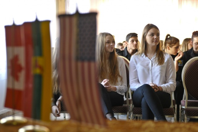 High school students listen to U.S. Army 1st Lt. Logan Gearhart (not pictured), platoon leader, Company D, 2nd Battalion, 503rd Infantry Regiment, 173rd Airborne Brigade, during an operations presentation and static display at the Lobez Culture Center in Poland, Nov. 10, 2016. The attendees were taught how the U.S., Canada and Poland share Nov. 11 as a national holiday and were familiarized with the Troops' equipment. (U.S. Army photo by Sgt. William A. Tanner)