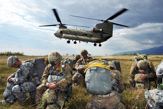 Paratroopers prepare to board a Chinook helicopter for an airborne operation