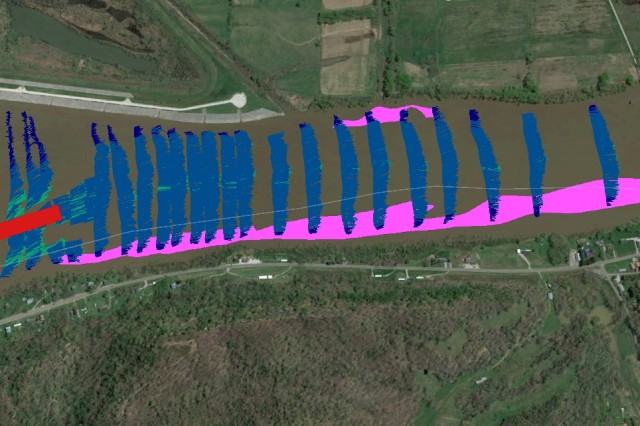 Figure 3. This aerial image shows the results of acoustic Doppler monitoring during dredging operations.  The dredge disposal area is shown as a red polygon.  The mussel beds are shown as light purple polygons along both banks.  Velocity vectors are shown as thin arrows ranging in color from blue (slow) to green to yellow to red (fast) depending on intensity of flow.