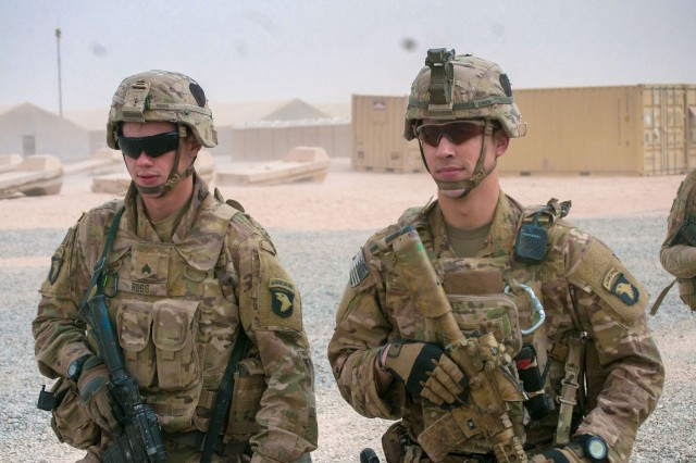 Sgt. Logon Ross, left, and Sgt. Addison Owen, right, Company B, 1st Battalion, 26th Infantry Regiment, Task Force Strike, 101st Airborne Division (Air Assault) in the U.S compound at the Qayyarah West Airfield, Iraq, Nov. 1, 2016. Company B provides security for Coalition forces on the base and was one on the first units at the location. Owen is an infantryman at the base and is on his second deployment to Iraq. On his first deployment in the city of Basra during 2010 to 2011, Owen was wounded when an explosively formed penetrator hit his vehicle.
