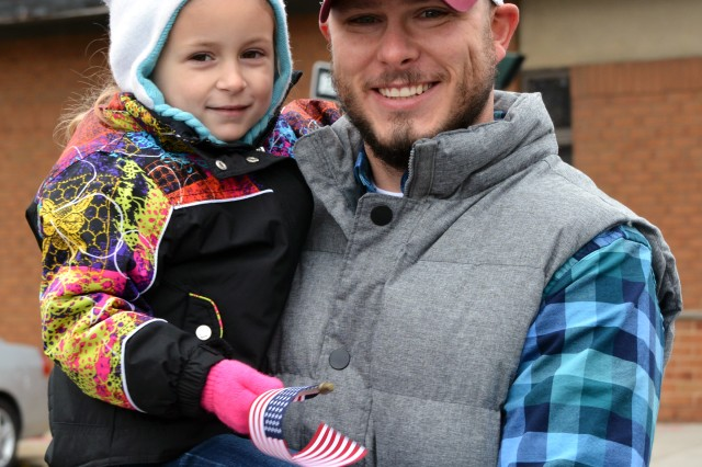 Leonard Mallery and his daughter marching in the parade.