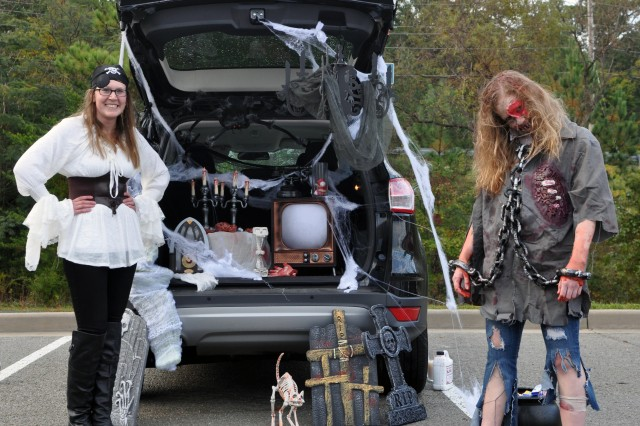 Sgt. Jennifer Lopez and Pfc. Allison Riddle, both of the U.S. Army Intelligence and Security Command (INSCOM) Headquarters and Headquarters Company, await trick-or-treaters at the Trunk or Treat event at Fort Belvoir's Main Exchange, Oct. 27.