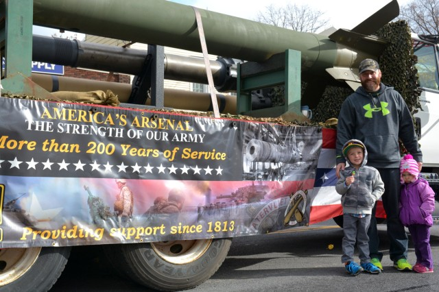 Michael Hastings with his son and daughter awaiting the start of the parade.