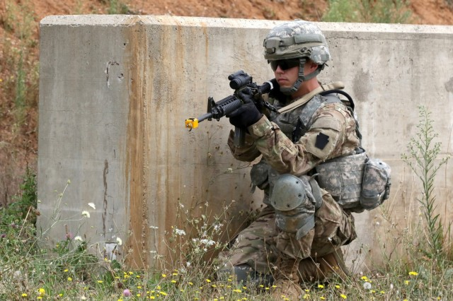 A Soldier assigned to the 2nd Infantry Brigade Combat Team, 28th Infantry Division pulls security for his squad during the U.S. Army Basic Leader Course held on Camp Bondsteel, Kosovo, August 1, 2016.