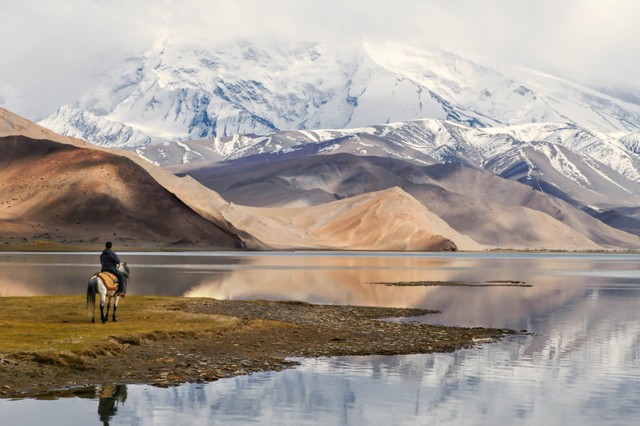 "Military family member Kimberly Kendall, representing U.S. Army Garrison Wiesbaden, Germany, wins first place in the nature and landscapes category, other eligible patrons division, of the 2015 Army Digital Photography Contest with ""Karakul Lake."""