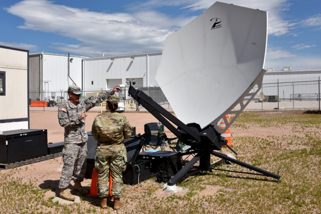 Sgt. 1st Class Taylor Michelsen, a Space Control Training instructor, teaches Spc. Jenna M. Goodwin, 1st Space Brigade, how to determine and adjust the polarization of the Patriot antenna during the Army Space Control Fundamentals course.