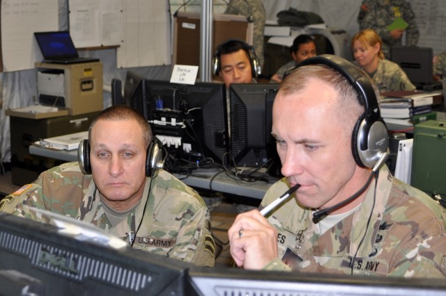 New York Army National Guard Major General Harry Miller (left) commander of the 42nd Infantry Division and Col. Jack James, commander of the 42nd Combat Aviation Brigade, monitor the brigade's activities during a  a two-week Warfighter command post exercise at Fort Indiantown Gap on Thursday, Nov. 10, 2016. The exercise is testing the staff skills the Soldiers need to handle a variety of complex aviation missions.