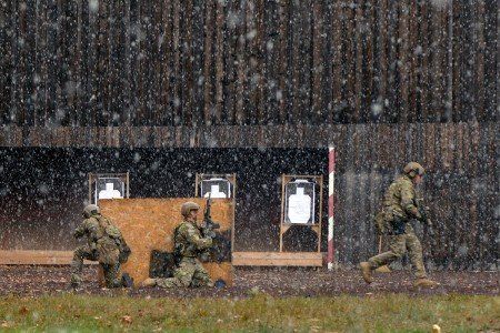 U.S. Soldiers assigned to 1-10th Special Forces Group maneuver through a shooting range during a weapons training exercise at the Panzer Range Complex, Boeblingen, Germany, Nov. 08, 2016.