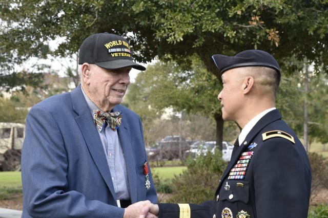 Brig. Gen. Viet Luong (right), USARCENT chief of staff, greets WWII Veteran David Phillips at the Florence, S.C. Veterans Day Ceremony Nov. 11, at the Florence, S.C. Veterans Park.