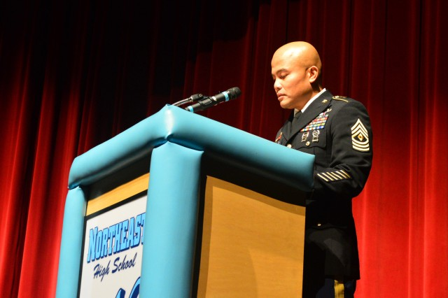 1st Sgt. Efren Delpilar, first sergeant, Headquarters and Headquarters Company, U.S. Army Sustainment Command, delivers keynote remarks during the North East School District's Veterans Day Program in Goose Lake, Iowa, Nov. 10. (Photo by Capt. Lonnie Collier, ASC Public Affairs)