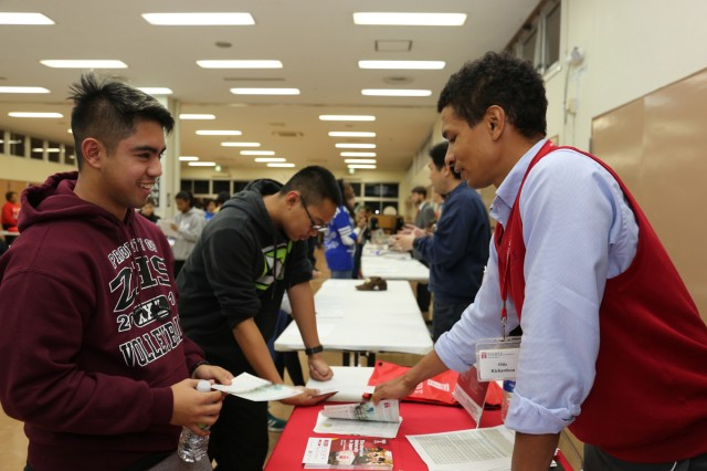 Camp Zama students receive information from admission counselor Otis Richardson, Temple University -- Japan Campus, during a college fair held Nov. 10 at Zama American High School. (U.S. Army photo by Lance D. Davis)