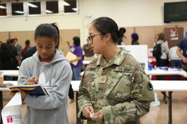 Naomi Starr, 7th-grader at ZAMS, reviews notes with her mother Maj. Nicole Starr, assigned to I Corps Forward, during the college fair held Nov. 10 at ZAHS. (U.S. Army photo by Lance D. Davis)