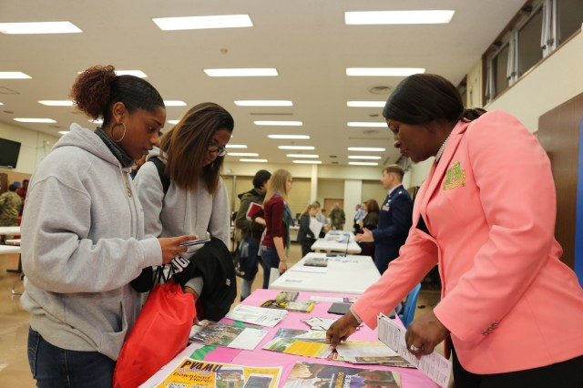 ZAHS students receive information on various historically black colleges and universities from Andrea King, volunteer and school nurse for ZAMS, during the college fair Nov. 10 at ZAHS.
