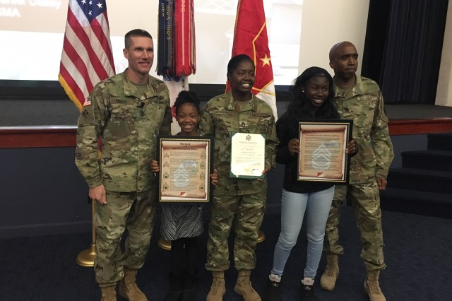 Sgt. Major of the Army Dan Dailey, left, stands with Sgt. 1st Class Marsha Galloway, center, and her family Nov. 7, 2016, on Fort Belvoir, Va., following her promotion ceremony.