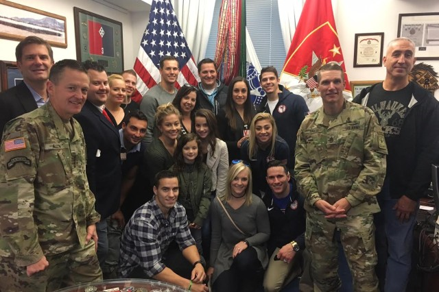U.S. Army Gen. Daniel Allyn, Vice Chief of Staff, left, and Sgt. Major of the Army Daniel Dailey pose for a photo with Team USA gymnasts during their visit to the Pentagon, Nov. 9, 2016.