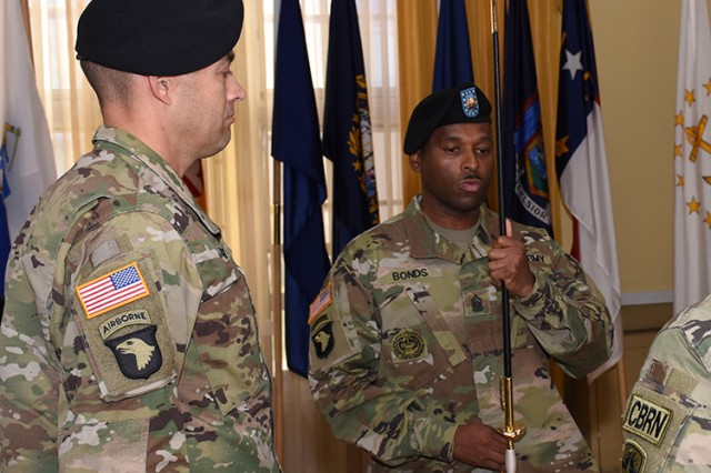 Command Sgt. Maj. Joe A. Bonds takes possession of the Model 1840 U.S. Army noncommissioned officer's sword, to show his acceptance of the responsibilities as the highest ranking enlisted Soldier at Dugway Proving Ground, Utah. To his right is Col. Sean Kirschner, commander of Dugway Proving Ground. Photo by Al Vogel / Dugway Public Affairs