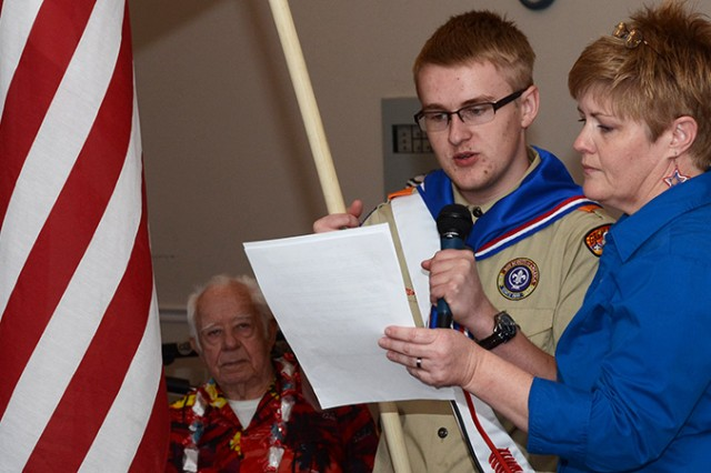 "Eagle Scout and flag-bearer Lane Taylor of Troop 868 helps Heather Slowik, food service director, recite the stirring ""I Am the Flag"" after emotions overcame her Nov. 11, 2016 at the Cottage Glen Assisted Living facility in Tooele, Utah. Three Soldiers from Dugway Proving Ground, Utah, also spoke to residents: Master Sgt. Russell Kruse, Sgt. Luis Guerrero and Sgt. Quoc Pham of the Dugway Health Clinic. Photo by Al Vogel / Dugway Public Affairs"