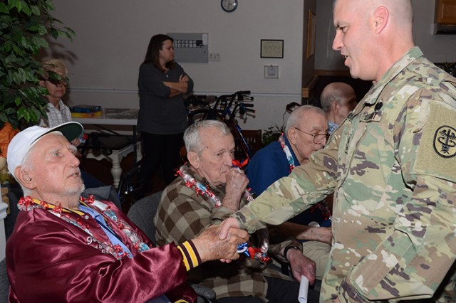 Three Soldiers from Dugway Proving Ground, Utah, spoke Nov. 11, 2016 -- Veterans Day -- to residents of Cottage Glen Assisted Living in Tooele, Utah. Master Sgt. Russell Kruse greets resident Tony Witkowski, who served with the Marines in the Korean War. Later, he was the civilian personnel officer at Dugway Proving Ground, and retired in 1991. Other Soldiers who spoke were Sgt. Luis Guerrero and Sgt. Quoc Pham, all of the Dugway Health Clinic. Photo by Al Vogel / Dugway Public Affairs