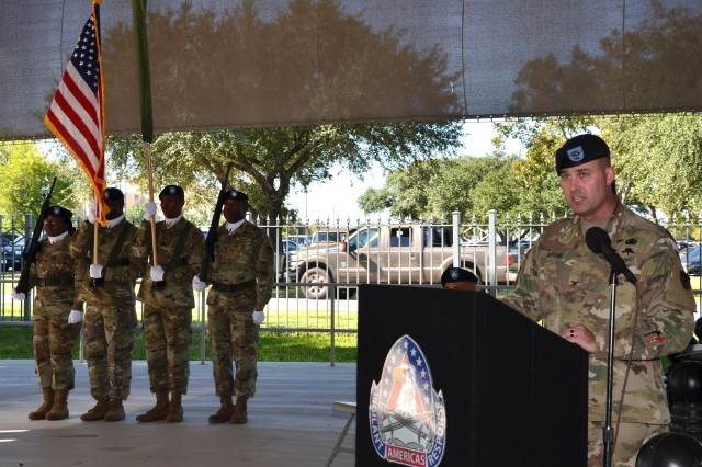 Col. Josh Burris addresses military leaders, brigade members, family and friends gathered for the 410th Contracting Support Brigade colors casing ceremony 16 at Joint Base San Antonio-Fort Sam Houston, Texas. Burris too the opportunity to praise the professionalism, commitment and selfless service of the Soldiers and civilian employee set to deploy in the coming days. They assume command of the Expeditionary Contracting Command-Afghanistan. Burris is the 410th CSB commander.