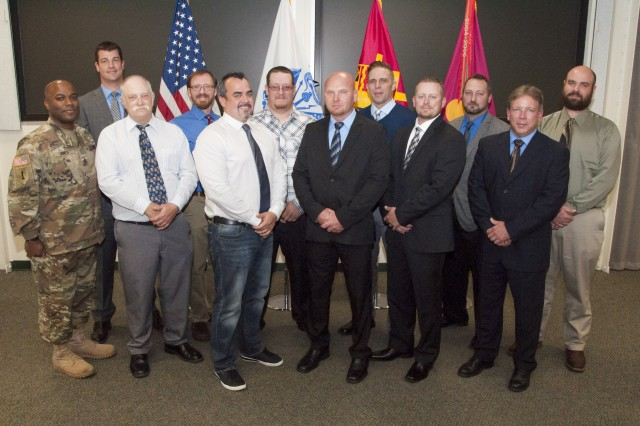 The 2016 graduating cohort of the Rock Island Arsenal-Joint Manufacturing and Technology Center's Machinist Apprentice Program celebrate following their commencement ceremony in the Baylor Conference Room, Building 103, RIA, Illinois, Nov. 4.