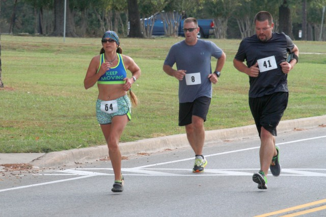 Zella Boatright charges past two competitors as she approaches the midway turnaround in the Veterans 5K Fun Run/Walk at McAlester Army Ammunition Plant, Oklahoma, November 5. Boatright finished first in the women's 40-49 year-old category and fourth overall in 24 minutes and 24.36 seconds.
