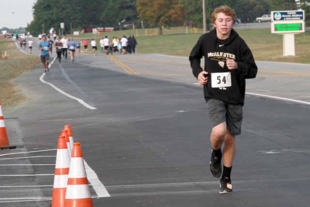 Kaden Webb makes the final push to the finish line during the Veterans 5K Fun Run/Walk at McAlester Army Ammunition Plant, Oklahoma, November 5. He finished seventh overall and first in boy's 14-19 year-old category in 27 minutes and 27.71 seconds.
