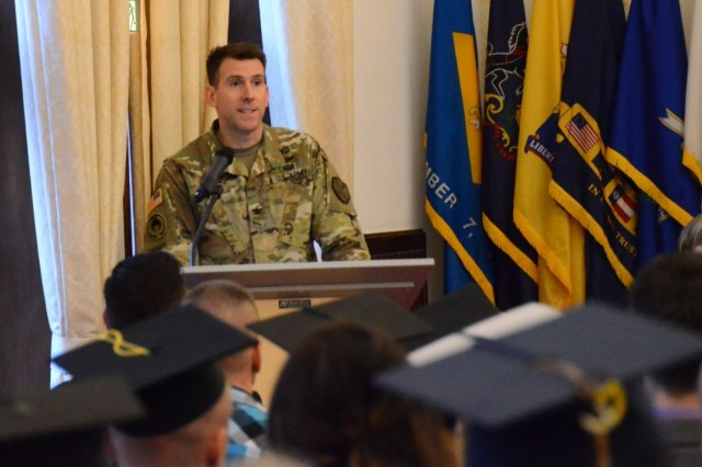 Col. Benjamin C. Jones, U.S. Army Garrison Ansbach commander, speaks during the garrison's Graduate Recognition Ceremony Nov. 16, 2016, at the Von Steuben Community Center in Ansbach, Germany. The ceremony highlighted the achievements of 35 college graduates from among 18 institutions of higher learning.