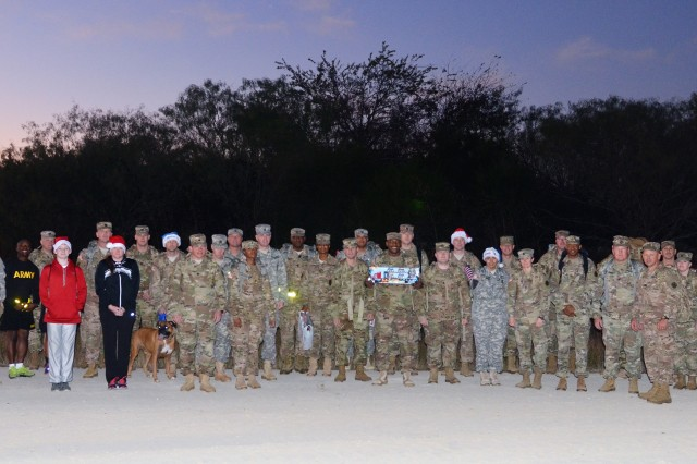 35 Soldiers form Headquarters Company, 13th Expeditionary Sustainment Command and community partners from the Belton Chamber of Commerce brought over 80 toys and games to Santa's Workshop during a ruck march on Nov. 17, 2016.