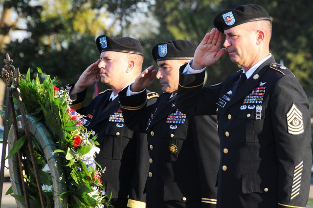 Maj. Gen. William K. Gayler, U.S. Army Aviation Center of Excellence and Fort Rucker commanding general, CW5 Joseph B. Roland, chief warrant officer of the Aviation Branch, and Command Sgt. Maj. Gregory M. Chambers, command sergeant major of the Aviation Branch, salute during the Veterans Day ceremony at Veterans Park Nov. 10.