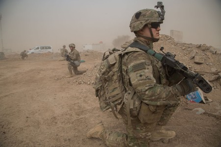 U.S. Army Spc. Devin Bowen, Company B, 1st Battalion, 126th Infantry Regiment, 2nd Brigade Combat Team, 101st Airborne Division, provides security during a key leader engagement to establish rapport among the Iraqi security force at Qayyarah West Airfield, Iraq, Nov. 1, 2016. The United States stands with a Coalition of more than 60 international partners to assist and support the Iraqi security forces to degrade and defeat the Islamic State of Iraq and the Levant.