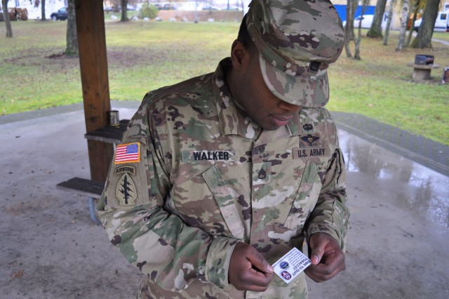 "VILSECK, Germany -- Staff Sgt. James Walker, both smokers, reads a BMEDDAC smoking cessation card during a work break under a pavilion on Rose Barracks during the Great American Smokeout, 17 Nov.  Walker elected to use the Smokeout day to quit ""cold turkey"" but admitted he had quit on several occasions before. U.S. Army Medical Department Activity Bavaria (BMEDDAC) clinic staffs in Ansbach, Grafenwoehr, Hohenfels, Stuttgart and Vilseck reached out to members of their respective communities 17 November at post exchanges, MWR venues and dining facilities in order to inform and encourage both tobacco smokers and dippers to quit for 24 hours. This year clinic representatives handed out special cards, ""Time to Quit Tobacco?"" with contact info to all clinics and make it easy for anyone considering quitting tobacco -- or anyone who knows and wants to encourage a smoker or dipper to quit.   To learn more about the people and facilities of the U.S. Army Medical Department Activity Bavaria (BMEDDAC) and the clinics they support in Ansbach, Grafenwoehr, Hohenfels, Stuttgart and Vilseck visit the BMEDDAC website at http://rhce.amedd.army.mil/bavaria"