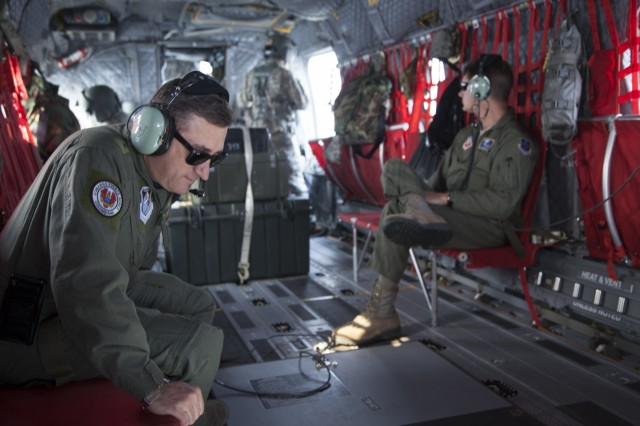 """Colombian Air Force Col. Juan C. Rocha, 12th Air Force, Air Forces South liaison officer, and U.S. Air Force Maj. Arthur """"Chip"""" Barton, 12th Air Force, ride on a South Carolina Army National Guard CH-47 Chinook from Det. 1, Bravo Company, 2-238th General Support Aviation Battalion with Soldiers from Donaldson Field in Greenville, South Carolina, that responded to a request for help from the South Carolina Forestry Commission to contain fires burning near the top of Pinnacle Mountain in in Pickens County, South Carolina, Nov. 15, 2016.  The aircraft is equipped with a Bambi Bucket, which can be filled with any available water to be transported and dumped on the fire."""