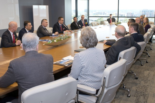 The Azerbaijani Ambassador to the United States, Elin Suleymanov (center left), speaks with directors and staff at the GE Global Research facility in Oklahoma City.
